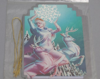 Best Vintage 80s gift tags // Woman holding a giant snowflake with reindeer // Christmas 1980s tag