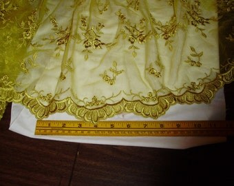 Organza antique gold embroidered flwrs & scalloped edges  54 wide