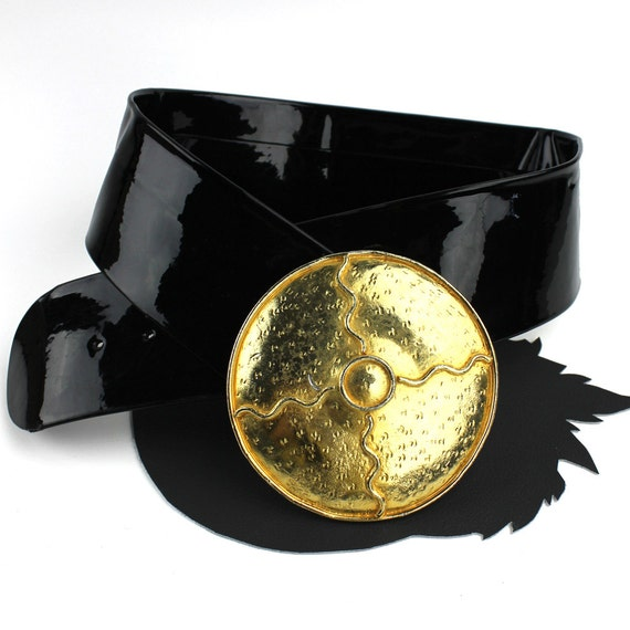wide black patent leather vintage belt with large gold circle
