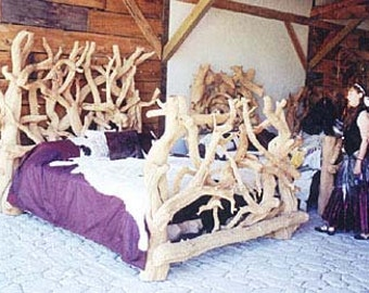 Hand carved log wolf bed