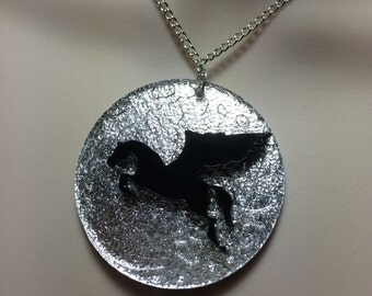 striking laser cut Acrylic flying horse 'PEGASUS' on an etched silver moon necklace