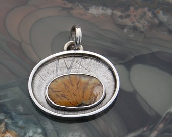 Plume agate pendent.