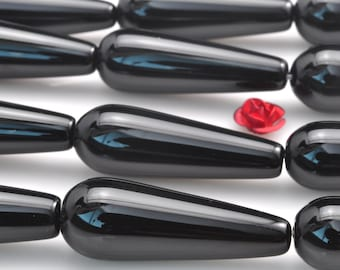 15 inches of Black Onyx smooth teardrop beads in 10x30mm