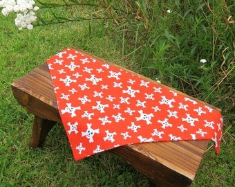 A doggy bandana. Size medium, 60cm x 27cm.  (23.5 inches x 10.6 inches)