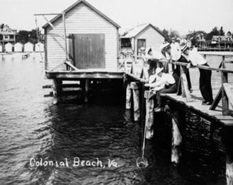 Crabbing from Pier at Colonial Beach Photograph (Art Prints available in multiple sizes)