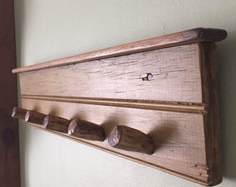 Hand made Rack with 5 Chestnut pegs....On antique Yellow/Goldish painted lumber.