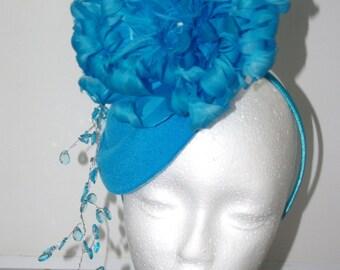 Designer Fascinator one of a kind. Blue Feather Flower Cascading Crystals