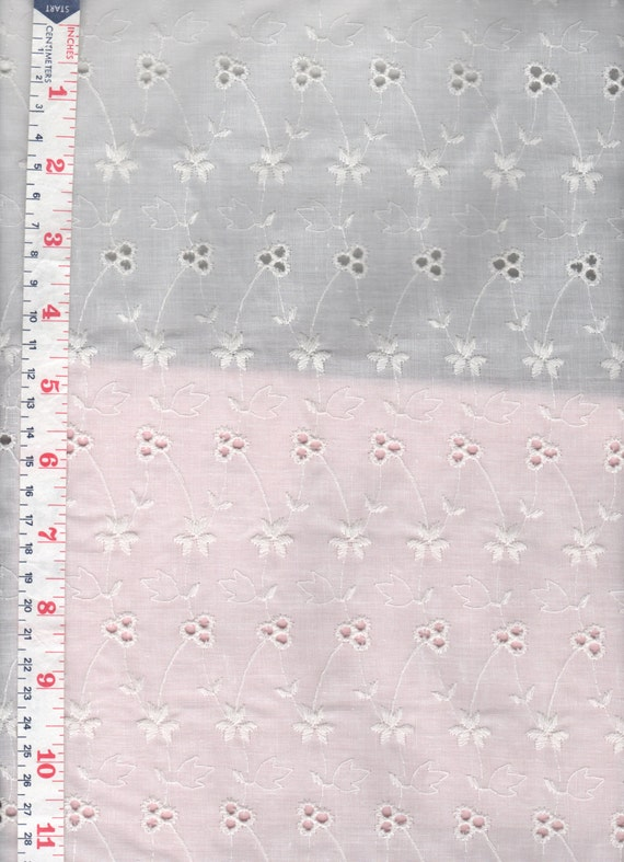 White floral eyelet embroidered fabric cotton blend sold by