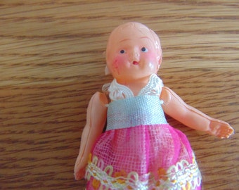 """Small, vintage plastic, GIRL doll for dollhouse. Molded, plastic doll. 4 1/2"""". blonde molded hair. Orogonal clothes."""