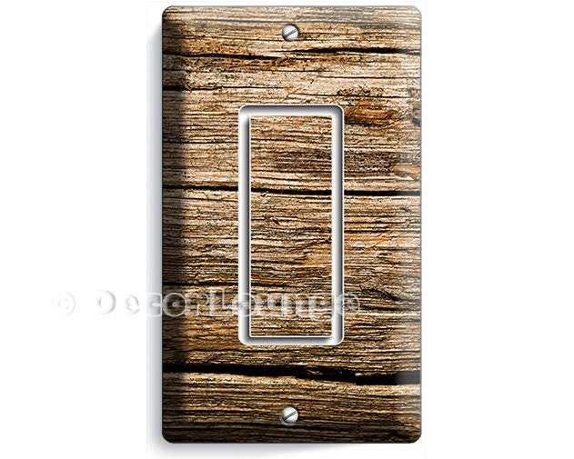 Worn out old rustic wood planks single GFCI light switch wall