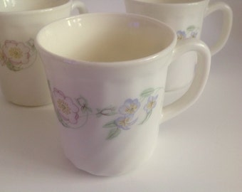4 coffee tea or cocoa mugs white swirl with floral transfer wild flower design marked Arcopal France