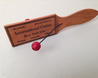 Advertising Noisemaker for International Casino NYC 1940s