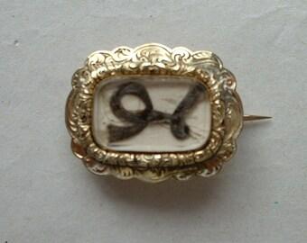 Victorian gold framed glazed mourning brooch