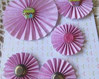 "Paper rosette/pinwheel type flowers, pink, silver buttons and cupcake buttons, 3"", 2"" and 1"" size."