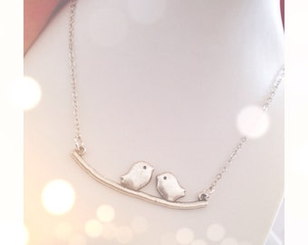 Silver necklace with birds on branch