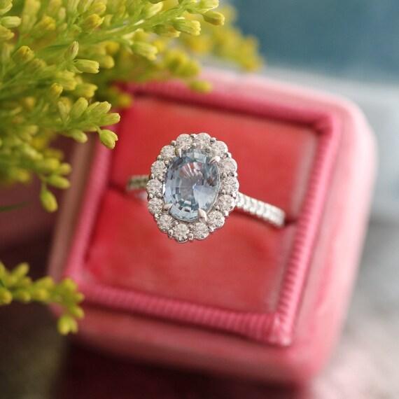 Pastel Blue Sapphire Engagement Ring Diamond Halo Wedding Ring. Energy Rings. Polish Wedding Rings. Groom Indian Wedding Rings. Melania Trump's Wedding Rings. Corundum Rings. Stubby Finger Engagement Rings. Luxurious Wedding Rings. Round Shaped Diamond Engagement Rings