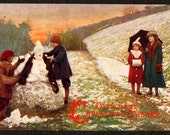 1906 Raphael Tuck Postcard Children Building Snowman, Christmas Wishes