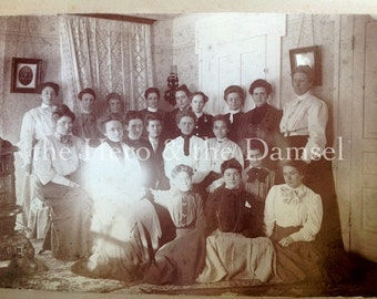 Ghost Among Them // Fashionable women gather by the wood burning stove // Antique photo, mounted on board