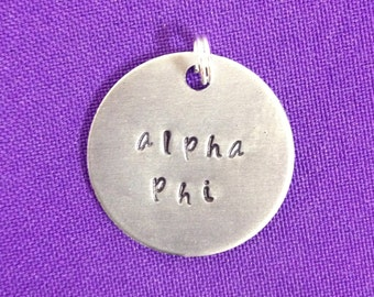 Handstamped Sorority Greek Alpha Phi charm made of non-tarnish aluminum, officially licensed