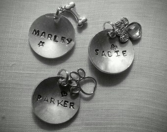 Hand stamped metal dog tags with charm