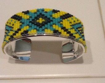 Hand beaded bracelet with bright, fun colors.