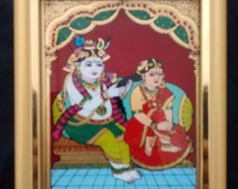 A beautiful Tanjore painting of Radha & Krishna.