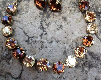 Swarovski crystal brown tone bracelet and earrings