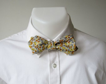 Diamond Point Bowtie, Freestyle, Self-tie.   Pale Grey Cotton with a tiny Black, Yellow, and Orange Design.  Ships from France Worldwide.
