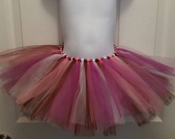On sale now. Tutu for ages 3-6 months. Great for photo props or dress up.