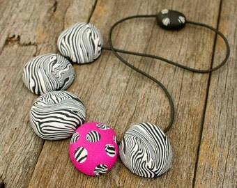 Statement necklace.  Contemporary, dramatic black and white zebra pattern with a neon pink feature bead.  Handmade by gingerdollstudio