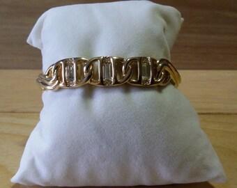 Swarovski braccialetto rigido placcato in oro con cristalli.