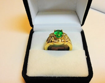 Emerald Gold Ring.  Set in 14kt Gold a 1.10ct. Natural Emerald with .56ctw. in Diamonds