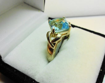 Swiss Blue Topaz Ring.   Princess cut set in a sterling silver ring.