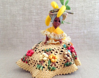 Plastic Souvenir Doll from Nassau in Yellow Top and Woven Straw Skirt with Fruit on Her Head
