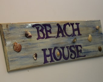 Beach House - cypress wood sign with seashells sealed into finish of sign.