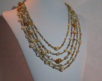 Pearl & Gold Multi Strand Opera/Matinee Length; Light Cream Pearl,Gold Beaded Necklace; Pearl,Gold Bracelet; Pearl gold Tassel Earrings