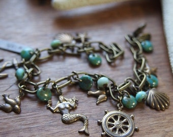 Sea green nautical charm bracelet // lovely collection of nautical charms // adjustable size // hand oxidized // B014