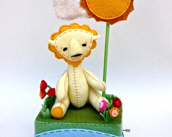 Here Comes the Sun hand crank music box with button jointed lion