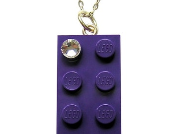 Purple LEGO (R) brick 2x4 with a Diamond color SWAROVSKI crystal on a Silver/Gold plated trace chain or on a Purple ballchain