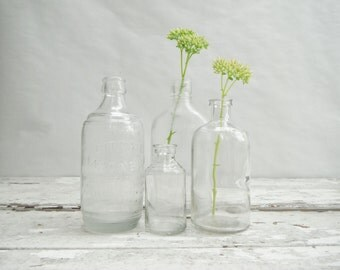 Vintage Clear Medicine Bottles. Set of 4