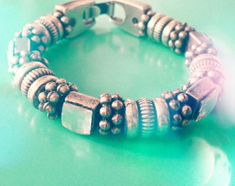 chunky silver bracelet with square stones