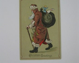 Christmas Vintage Post Card - Brown Suited Santa with Toy Sack and Walking Stick - Germany - Used - 1911