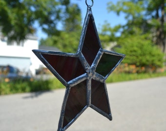 Stained glass star ornament - in red and green hues
