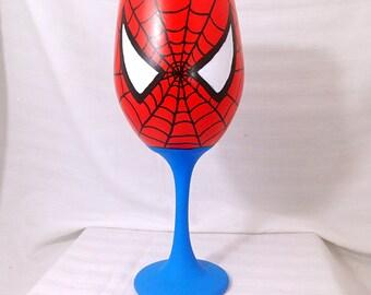 Superhero inspired hand painted wine glass.