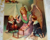 Antique Gel Christmas Postcard  Angel Helps Children Put Toy Together