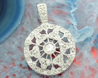 0.55 Carats T.W. 14 Karat White Gold Ladies Vintage Diamond Pendant.
