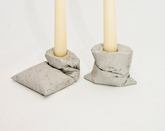 The Kappa candleholders are a product of the design studio LJ LAMPS.