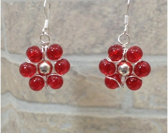Red glass wire wrapped flower with silver center hook earrings