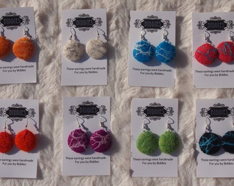 Handmade felted dangle earrings by Biddies. Available in different colors. Fine merino wool and beautiful silk accents.