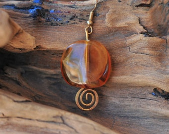 Honey & Amber hued earrings with gold tone spirals . Dangling Earrings